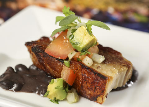 The Crispy Pork Belly with Black Beans, Onions, Avocado and Cilantro, from the new Brazil kiosk, featured in the upcoming 2013 edition of the Epcot International Food & Wine Festival, which runs Sept. 27 through November 11. Photographed Friday, August 23, 2013, in an exclusive Orlando Sentinel behind-the-scenes preview. (Joe Burbank/Orlando Sentinel) B583075881Z.1
