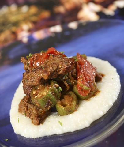 From the Africa kiosk, Berbere Style Beef with Onions, Jalape¿os, Tomato, Okra and Pap Grits, featured in the upcoming 2013 edition of the Epcot International Food & Wine Festival, which runs Sept. 27 through November 11. Photographed Friday, August 23, 2013, in an exclusive Orlando Sentinel behind-the-scenes preview. (Joe Burbank/Orlando Sentinel) B583075881Z.1