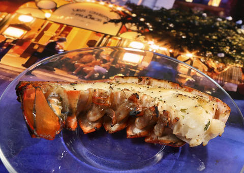 A Griddled Lobster Tail with Garlic Herb Butter, featured in the upcoming 2013 edition of the Epcot International Food & Wine Festival, which runs Sept. 27 through November 11. Photographed Friday, August 23, 2013, in an exclusive Orlando Sentinel behind-the-scenes preview. (Joe Burbank/Orlando Sentinel) B583075881Z.1