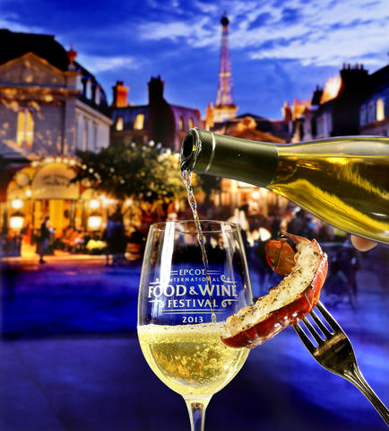 A Griddled Lobster Tail with Garlic Herb Butter and a classic white wine in front of a dusk scene at France; some of the new food & beverage items featured in the upcoming 2013 edition of the Epcot International Food & Wine Festival, which runs Sept. 27 through November 11. Photograp