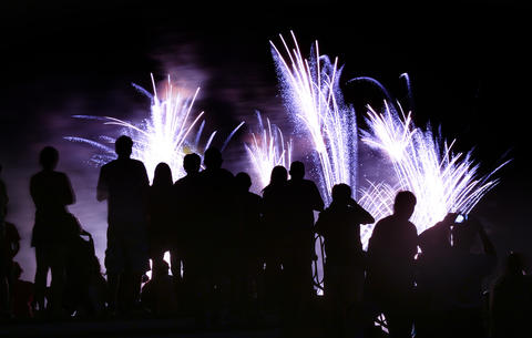 FANS & FIREWORKS: Fireworks silhouette Epcot fans watching the 'Illuminations' show from the bridge at the Italy pavilion, at Epcot, Wednesday, September 18, 2013, in anticipation of the 18th annual Epcot International Food & Wine Festival, with runs Sept. 27 through Nov. 11, at Walt Disney World. (Joe Burbank/Orlando Sentinel) B583197404Z.1 ..