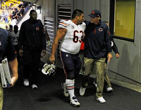 Roberto Garza and coach Marc Trestman talk as they leave the field after the win.