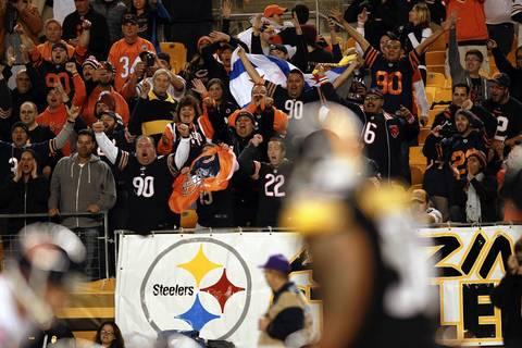 Bears fans celebrate in final minute of a 40-23 win.