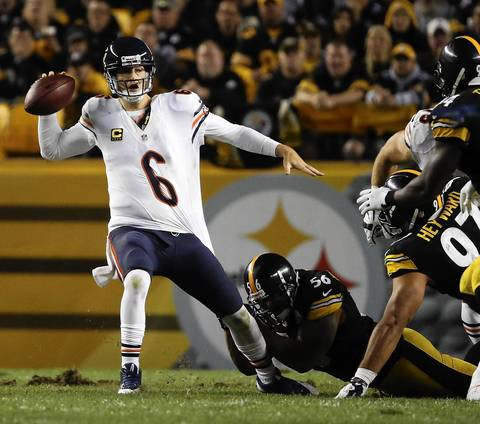 Jay Cutler gets the ball off under pressure from Steelers linebacker LaMarr Woodley in the fourth quarter.