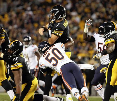 Linebacker James Anderson hits Steelers quarterback Ben Roethlisberger in the third quarter.
