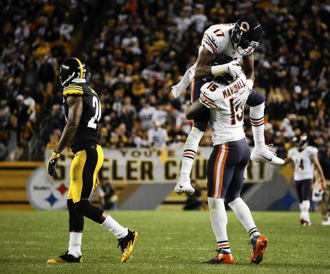 Alshon Jeffery and Brandon Marshall celebrate Marshall's long touchdown reception as the Steelers' Ike Taylor (24) walks away in the fourth quarter.