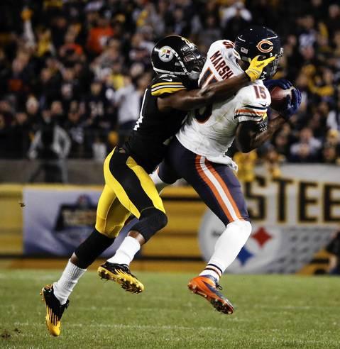 Brandon Marshall makes a long reception against Steelers cornerback Ike Taylor.