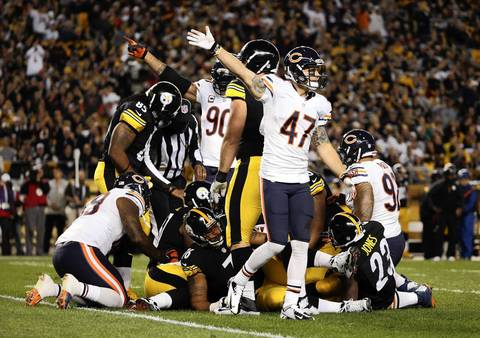 The defense celebrates as Chicago Bears outside linebacker James Anderson (50) recovers a fumble in the first quarter against the Pittsburgh Steelers.