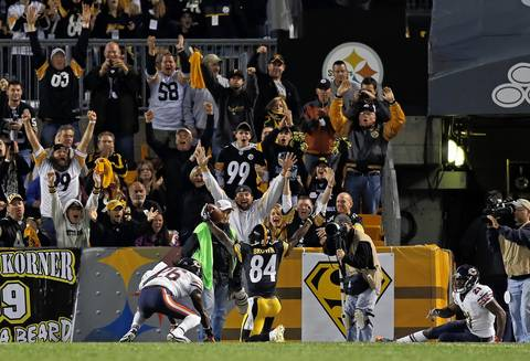 Tim Jennings and Major Wright watch as the Steelers' Antonio Brown celebrates his 2nd quarter touchdown reception.
