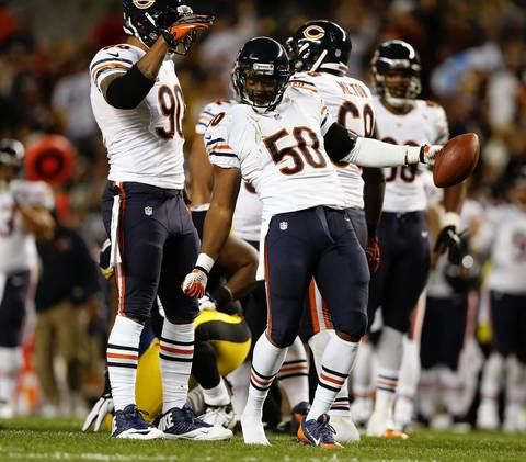 Chicago Bears' James Anderson celebrates a first quarter fumble recovery against the Pittsburgh Steelers.
