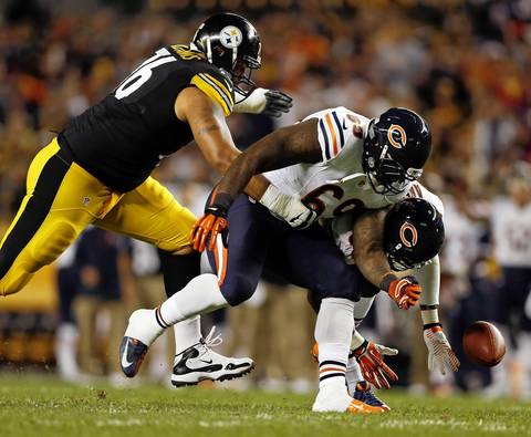 Chicago Bears' James Anderson and Henry Melton chase a fumble with Pittsburgh Steelers' Mike Adams in the first quarter.
