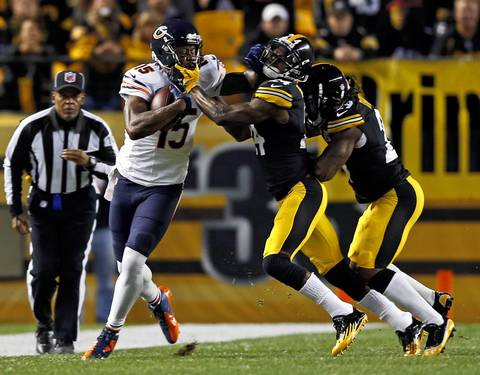 Chicago Bears' Brandon Marshall fends off a tackle attempt by Pittsburgh Steelers' Ike Taylor in the first quarter.