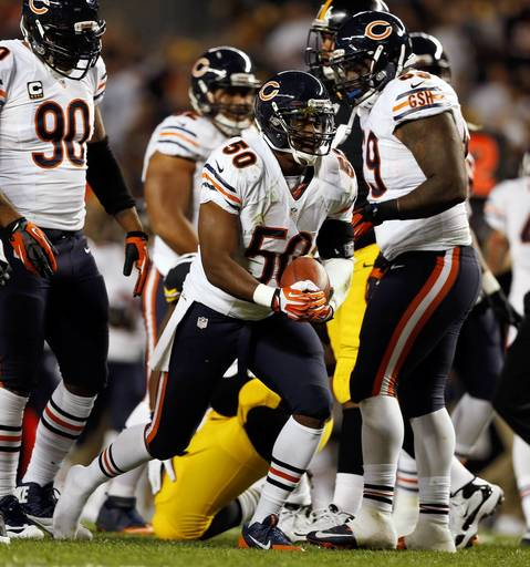 Chicago Bears' James Anderson celebrates his 1st quarter fumble recovery against the Pittsburgh Steelers.