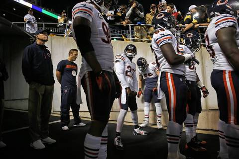 Chicago Bears' Devin Hester (23), head coach Marc Trestman, left, and other team members wait to take the field for pregame warm up before playing Pittsburgh Steelers at Heinz Field in Pittsburgh.