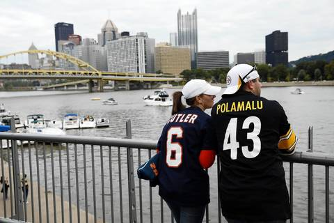 Bears fans Cal and Kathleen Nate of Schererville, Indiana look out over the Allegheny River.
