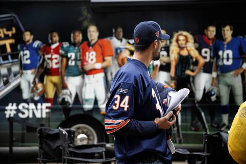 Bears fan Gary Fusco of New Castle, Pennsylvania looks at a Sunday Night Football bus.