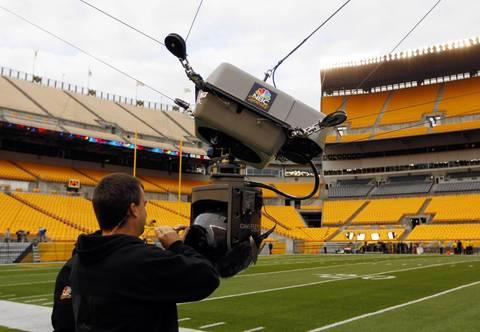 An NBC Sports technician prepares the overhead camera.