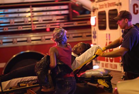 A shooting victim is taken from the scene near the intersection of 50th Street and Wood Streets in Chicago.