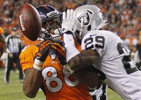 Oakland Raiders safety Brandian Ross (R) breaks up a pass near the endzone to Denver Broncos wide receiver Demaryius Thomas during the third quarter of their NFL football game in Denver September 23, 2013.