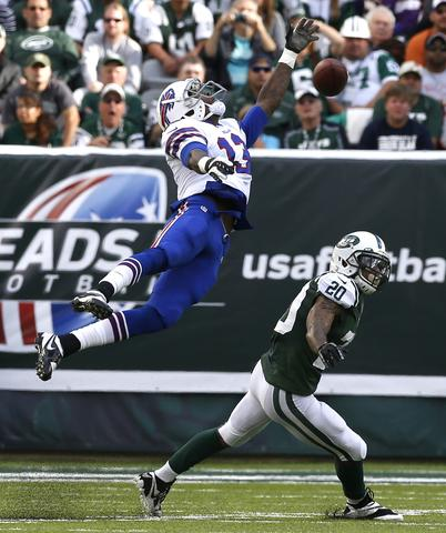 Buffalo Bills wide receiver Steve Johnson (13) stretches but fails to reach a pass in front of New York Jets cornerback Kyle Wilson (20) in the second quarter during their NFL football game in East Rutherford, New Jersey, September 22, 2013. The Jets won the game 27-20.