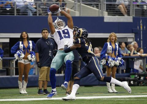 Dallas Cowboys wide receiver Miles Austin (19) goes up for the catch as he is defended by St. Louis Rams corner back Janoris Jenkins in the second half of their NFL football game in Arlington, Texas September 22, 2013.