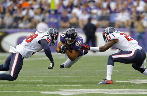 Baltimore Ravens wide receiver Brandon Stokley (80) dives for a first down after catching a pass against Houston Texans strong safety Danieal Manning (38) and cornerback Brice McCain during the second quarter of their NFL football game in Baltimore, Maryland September 22, 2013.