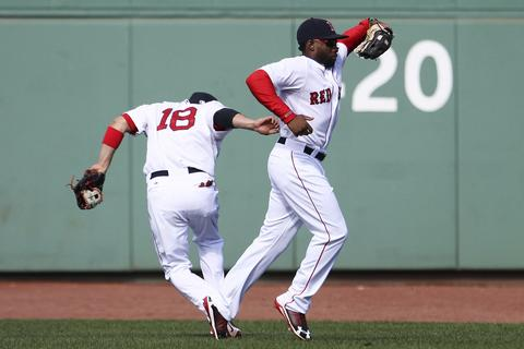 Boston Red Sox Jackie Bradley Jr. (R) hauls in the ball after catching the fly from Toronto Blue Jays Moises Sierra in the sixth inning during their MLB American League East baseball game in Boston, Massachusetts, September 22, 2013.