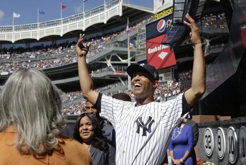 New York Yankees relief pitcher Mariano Rivera reacts to the crowd as they cheer him in Monument Park as he is honored in ceremonies before their MLB lnterleague game with the San Francisco Giants at Yankee Stadium in New York, September 22, 2013.