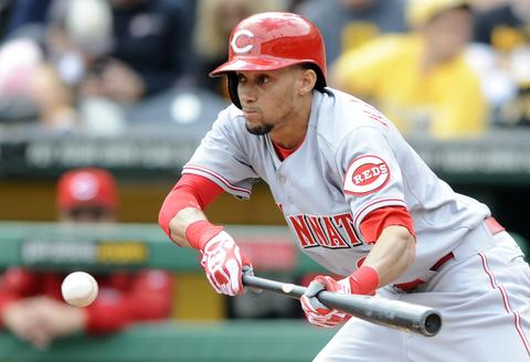 Cincinnati Reds' Billy Hamilton bunts for a single against the Pittsburgh Pirates in the second inning of their MLB National League baseball game in Pittsburgh, Pennsylvania September 22, 2013.