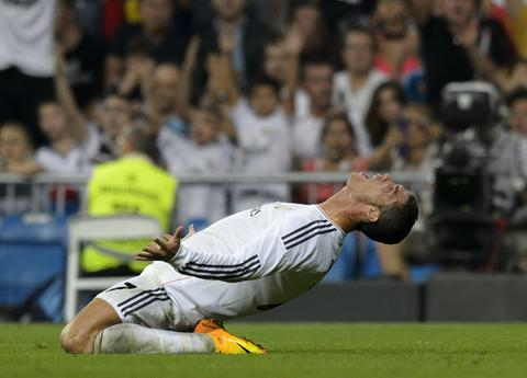 Real Madrid's Portuguese forward Cristiano Ronaldo reacts during the Spanish league football match Real Madrid CF vs Getafe CF at the Santiago Bernabeu stadium in Madrid on September 22, 2013.