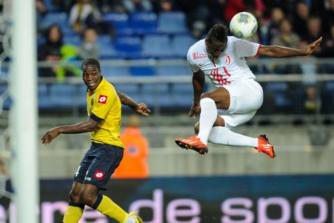 Lille's French midfielder Soualiho Meite (R) vies with Sochaux' Ivorian midfielder Thierry Doubai (L) during the French L1 football match between Sochaux (FCSM) and Lille (LOSC) on September 21, 2013, at the Auguste Bonal Stadium in Montbeliard, eastern France.