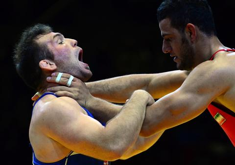 Iran's Mahdi Abbas Aliyarifeizabadi (R, red) and Hungary's Balazs Kiss fight during the men's Greco-Roman style 96 kg category bronze match of the FILA World Wrestling Championships in Budapest on September 21, 2013. Kiss won the bronze medal.