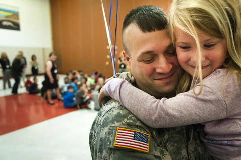 2013.09.23 - Southington, CT - Madison Howes, a Flanders Elementary third-grader, hug her father, Staff Sergeant Michael Howes, as she sees him for the first time since his nine-month military deployment to Djibouti.