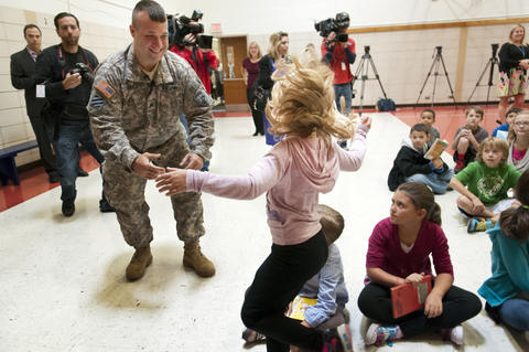 2013.09.23 - Southington, CT - Madison Howes, a Flanders Elementary third-grader, runs to her father, Staff Sergeant Michael Howes, as she sees him for the first time since his nine-month military deployment to Djibouti.