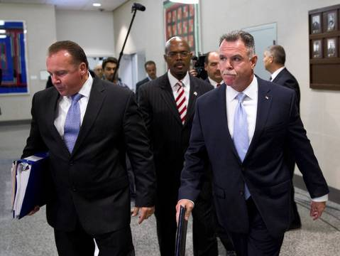 Chicago Police Superintendent Garry F. McCarthy, right, leaves a press conference with other police officials at Chicago Public Safety Headquarters after discussing the shootings at Cornell Square Park last night that left 13 people wounded.