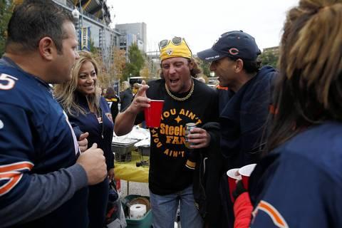 Steelers fan Greg Jursinic of Joliet (center) is razzed by Chicago-area Bears fans.