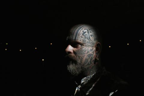 Tattoo artist Matt Black displays tattoos on his head during the ninth London International Tattoo Convention in London September 27, 2013.