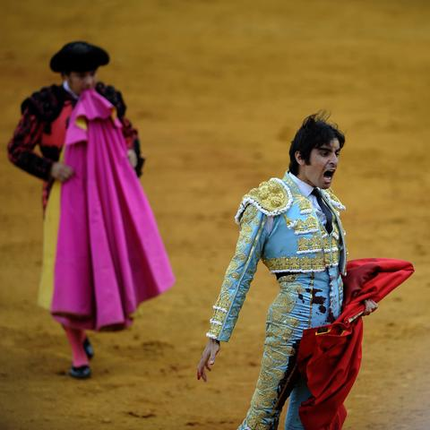 Spanish matador Miguel Angel Perea reacts after killing a bull during a bullfight at the Maestranza bullring in Sevilla on September 28, 2013.