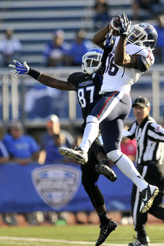 Byron Jones of UConn, right, breaks up a pass intended for Buffalo's Brian Orzechchowski in the second quarter.