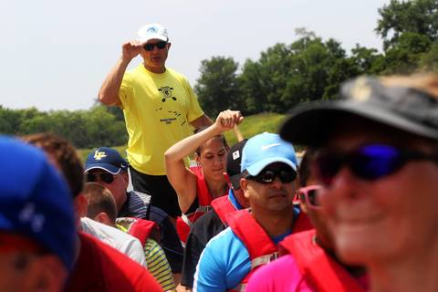 Marek Mroz, co-captain of the Windy City Dragons coaches the Adaptive Adventure's Wounded Warrior Team to do dragon boating on Lake Arlington in Arlington Heights.