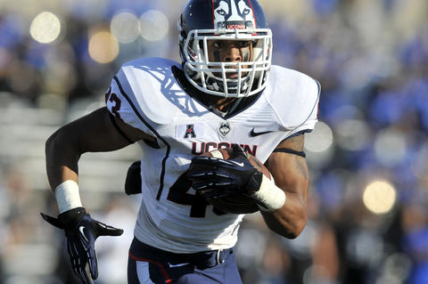 Lyle McCombs rushes during the first half of UConn's 41-12 loss.