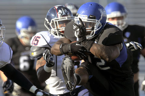 Branden Oliver of Buffalo rushes during UConn's 41-12 loss.