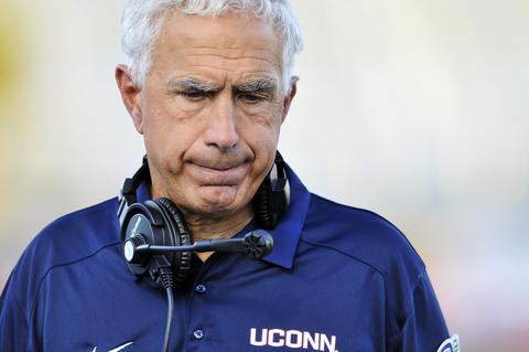 UConn head coach Paul Pasqualoni stands on the sideline during the final quarter of UConn's 41-12 loss to Buffalo.