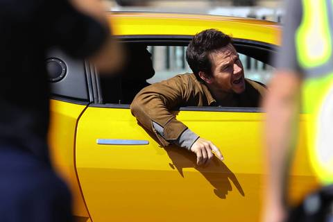 Mark Wahlberg hangs out of Bumblebee.