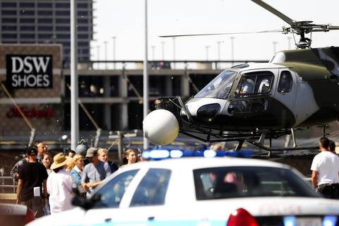 A helicopter flies close to the bridge to shoot a scene.