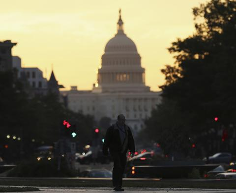 The United States Capitol dome is seen down Pennsylvania Avenue in Washington September 30, 2013. With a deadline to avert a federal government shutdown fast approaching, the U.S. Capitol was eerily quiet on Sunday as Republicans and Democrats waited for the other side to blink first and break the impasse over funding.