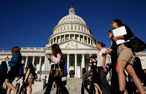 WASHINGTON, DC - SEPTEMBER 30:  Tourists walk past the U.S. Capitol as the Congress remains gridlocked over legislation to continue funding the federal government September 30, 2013 in Washington, DC. The House of Representatives passed a continuing resolution with language to defund U.S. President Barack Obama's national health care plan two days ago, but Senate Majority Leader Harry Reid has indicated the U.S. Senate will not consider the legislation as passed by the House.