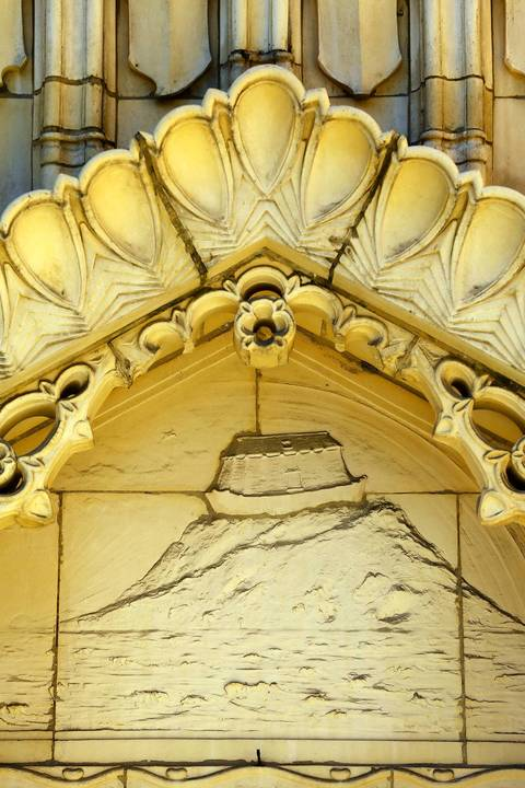 Noah's Ark above the door of the main entrance to Saint Thomas the Apostle Roman Catholic Church in the Hyde Park neighborhood.