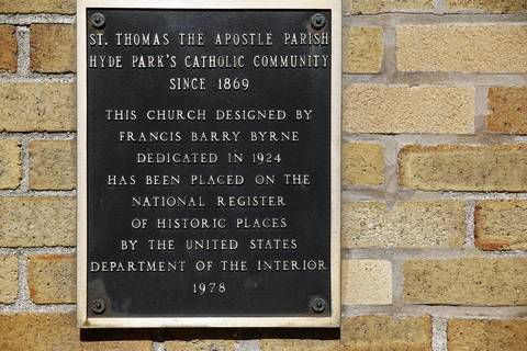 A marker on Saint Thomas the Apostle Roman Catholic Church.
