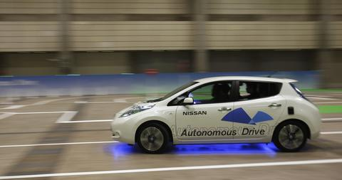 "A staff of Nissan and media crew drive the LEAF electronic car, with new a driving system ""Autonomous Drive"", which utilises sensors and cameras to drive automatically, during a media preview of CEATEC (Combined Exhibition of Advanced Technologies) JAPAN 2013 in Chiba, east of Tokyo, September 30, 2013. A total of 587 companies and organizations are exhibiting at CEATEC JAPAN 2013, which will be held until October 5, 2013."